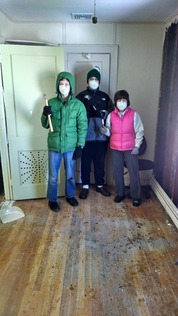 the guys and Julie DRE with hammers and masks